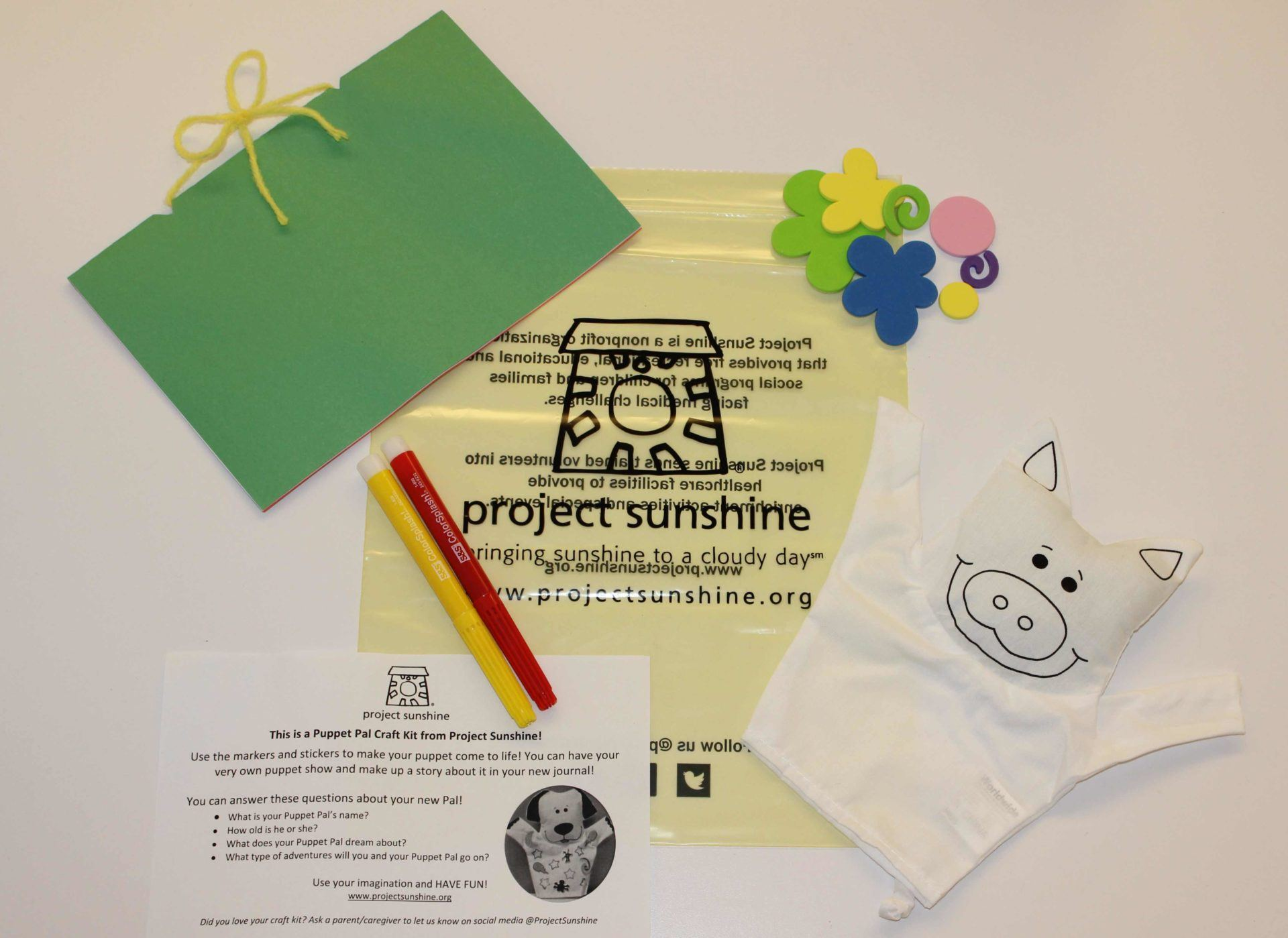 Journal, stickers, instructions, plain puppet and fabric markers from the Puppet Pals arts and crafts kit